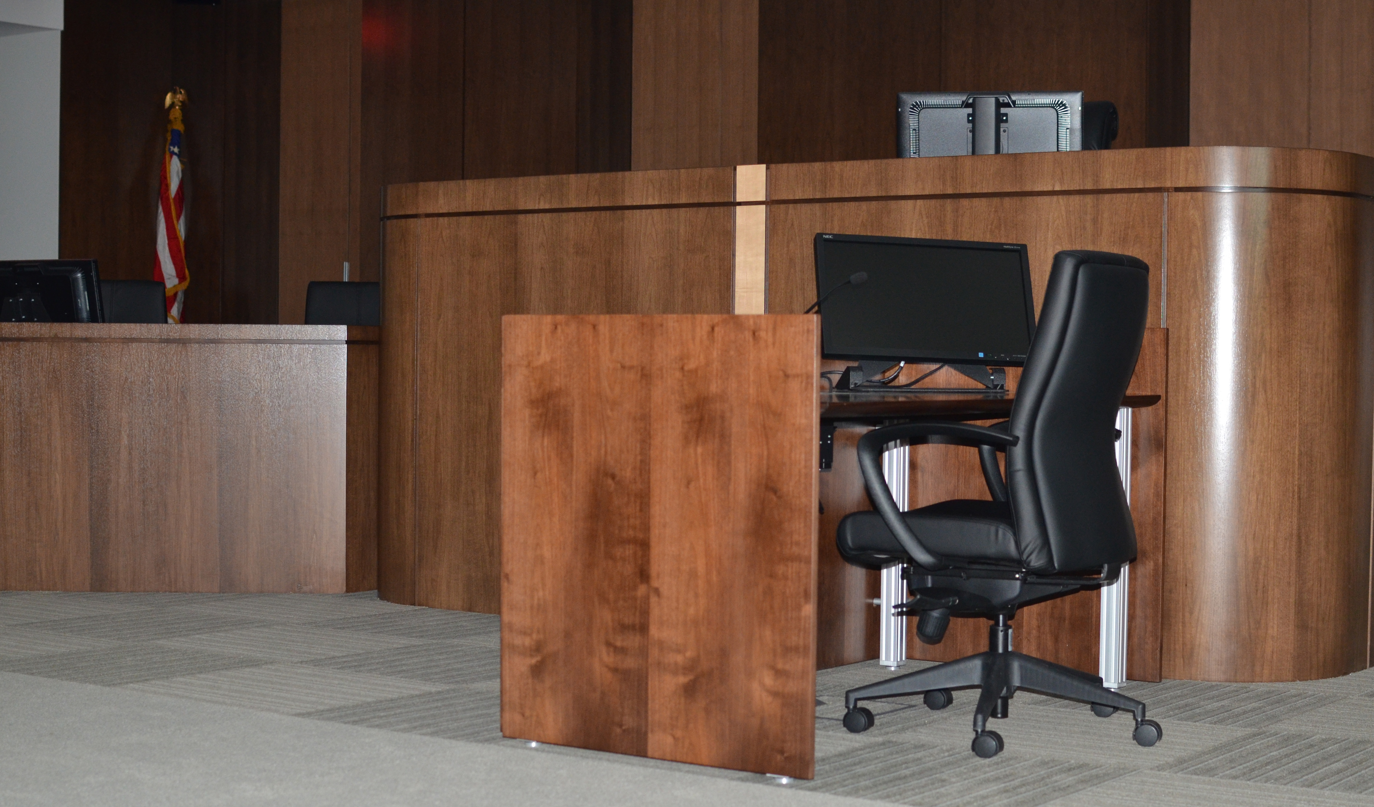 The judge's bench, the clerk's desk, and the court reporter's station -- all equipped with computer screens and audio connections to allow easier access to complex information often crucial in intellectual property infringement trials.