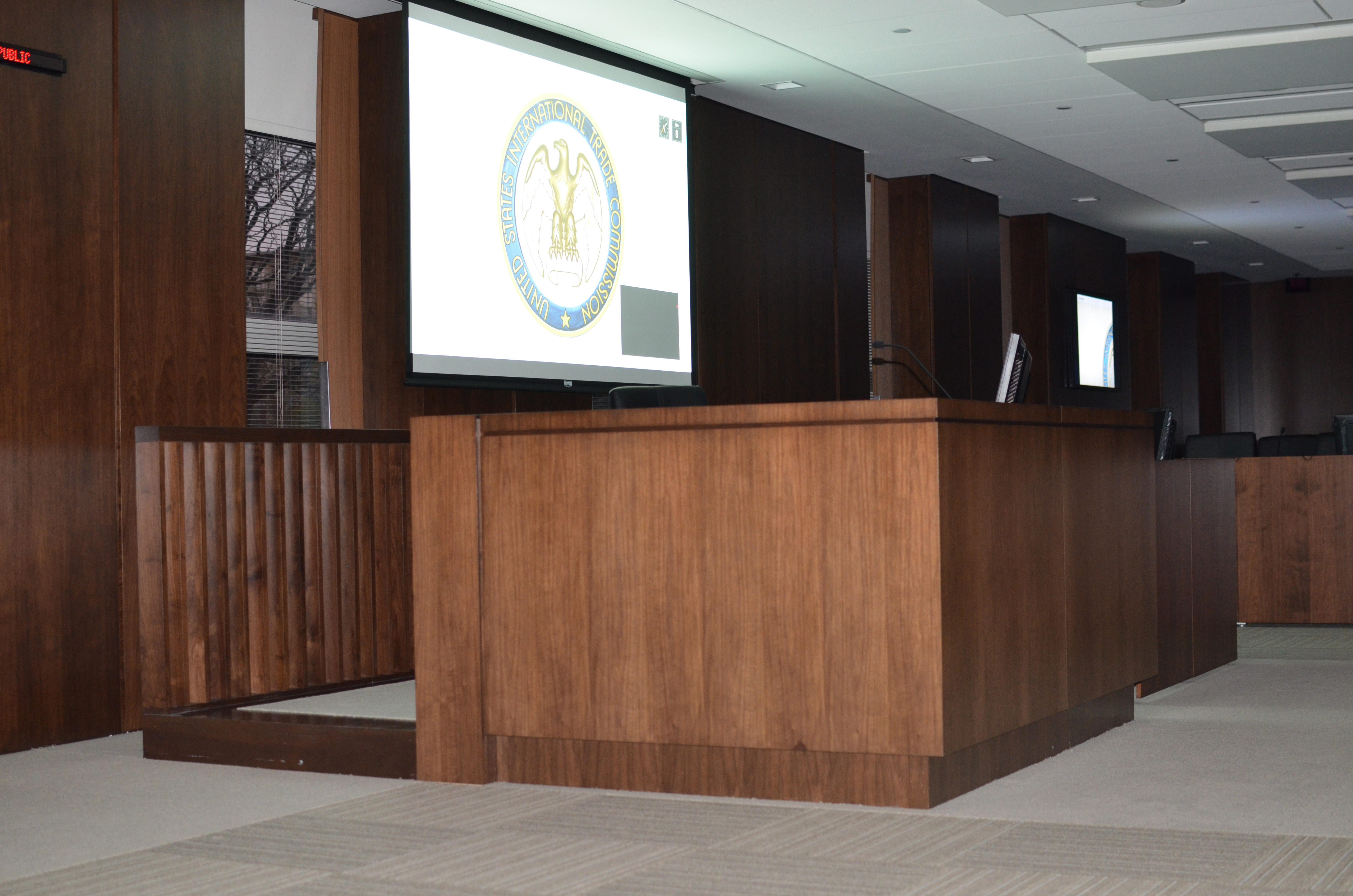 Desk-mounted and wall-hung presentation screens around the room ensure that all participants have clear access to materials under discussion.  Automated window screens help protect confidential business information by ensuring that individuals outside the courtroom cannot view the proceedings when they are closed.